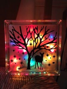 cute i want to do this with a different vinyl design love the colored lights behind the etched glass block