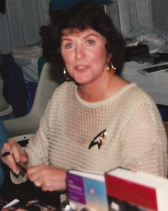 "As the wife of Roddenberry and given her ongoing relationship with Star Trek—participating in some way in every series during her lifetime—she was sometimes referred to as ""the First Lady of Star Trek"""