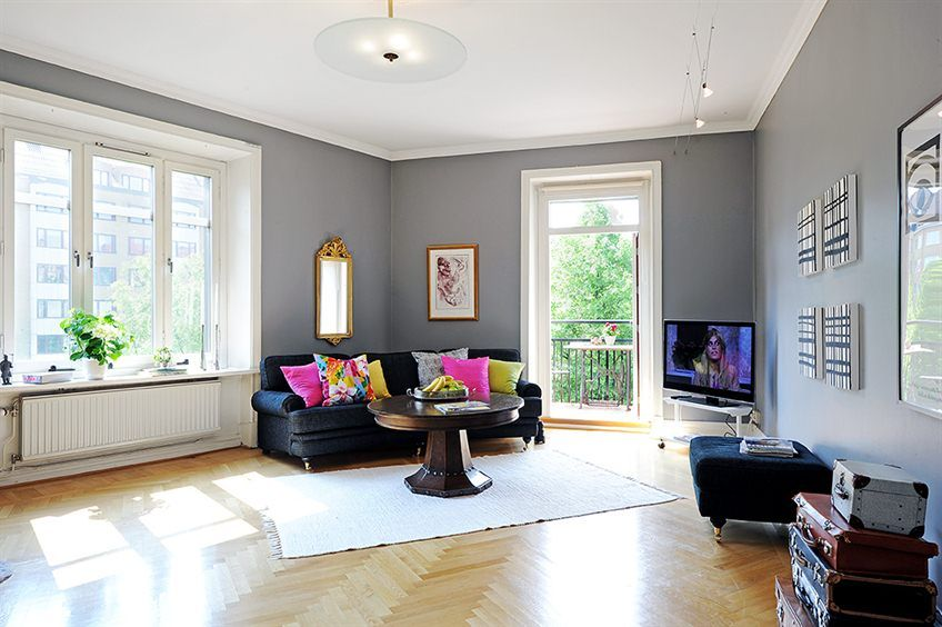 Black couch with colorful pillows!