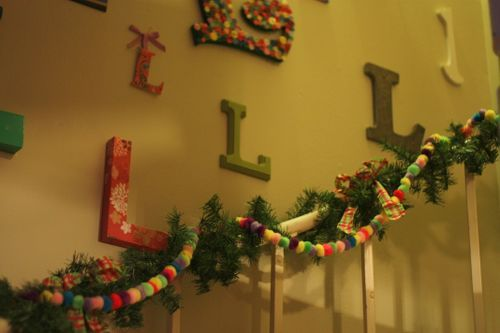 pom pom garland is needed.. I love the wall... I could do a wall of ...