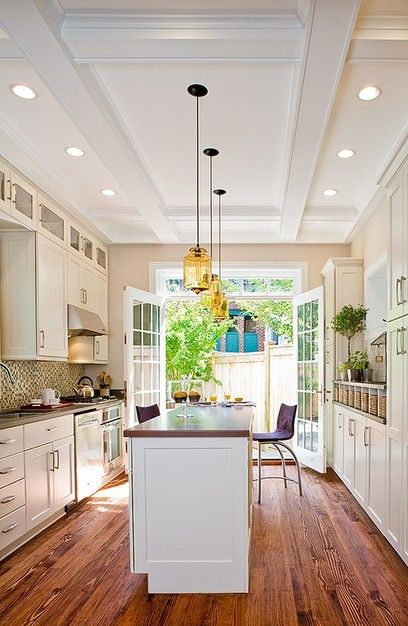 Incredible Galley Kitchen Design With A Long Island The Wood Grain Runs Length Of Room Making It Feel Even Larger