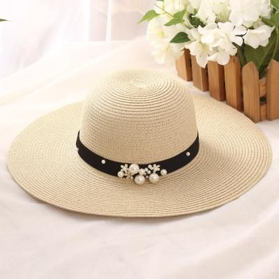 5398937a4ff HSS Hot Sale+Flat top straw hat Summer Spring women s trip caps leisure pearl  beach sun hats M letter breathable fashion flower