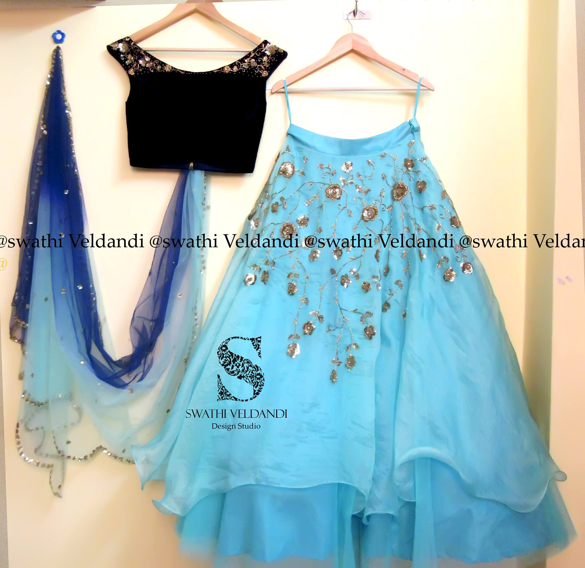 8fb9482718c6b8 Beautiful lehenga in sky blue color with dark off shoulder blouse in boat  neck with embroidery on sleevesand creeper design embroideryon the lehenga.