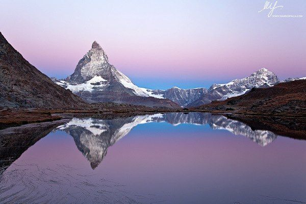 Earth Shot Of the Day    Wednesday, 24th October 2012    Heaven Is a Place On Earth    By Mario Spalla    Heaven....after a night alone in tent, at 2800mt, in the Swiss Alps...the Matterhorn reflect his face into the wonderful Riffel lake (Rifelsee).    Equipment: Canon Eos 5D Mark2 and 24-105mm    For HQ version :     http://www.earthshots.org/2012/10/heaven-is-a-place-on-earth-by-mario-spalla/