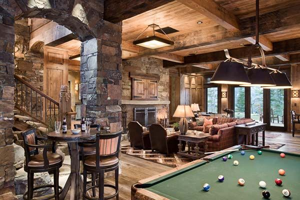 Rustic Mountain Home With Breathtaking Views Over Big Sky Country Rustic Basement Traditional Family Rooms Rec Room