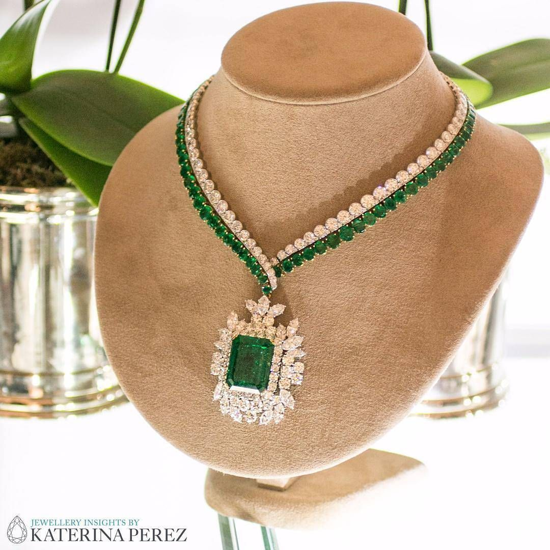 An emerald and diamond pendant necklace by harry winston is going