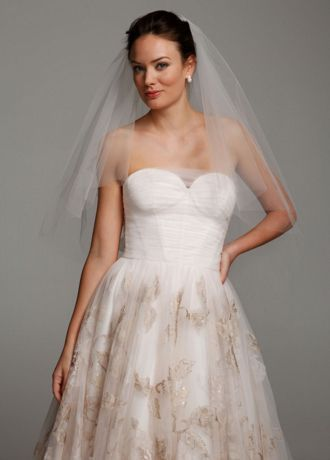 "This Oleg Cassini veil is the perfect accessory to top off your look on your special day!  Veil comes adorned with lovely, bold flower appliques and is designed to match back perfectly with Oleg gown style CWG614.  Available in: Ivory.  Measures 34""/42""L x 69""W.  Fabric Content: Nylon Tulle.  Imported."
