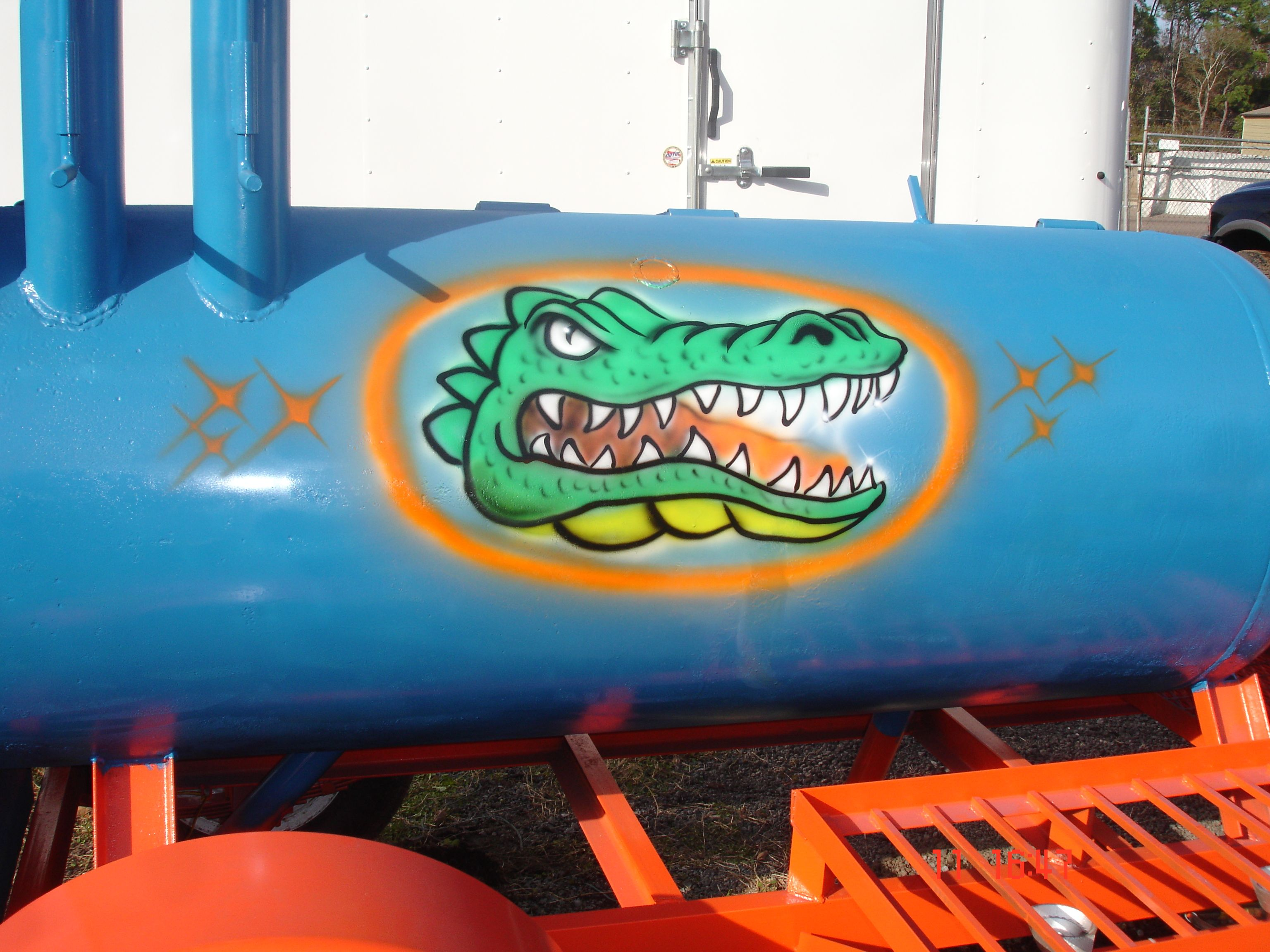 Model 120 bbq smoker on a trailer with florida gator colors built by m