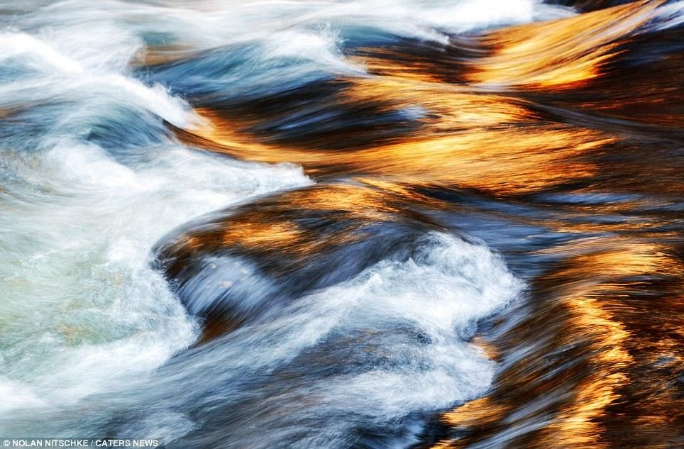 The Californian photographer also captured this image of the sun reflecting on a fast-moving river. (Nolan Nitschke/ Caters News)Yosemite