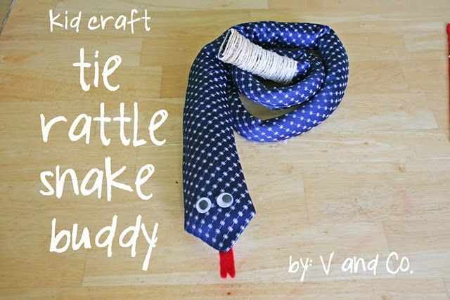 tie rattle snake buddy (i would recommend sewing instead of gluing if this is intended for a baby, also on sewing the snake into a coil so it can't be wrapped around a neck)
