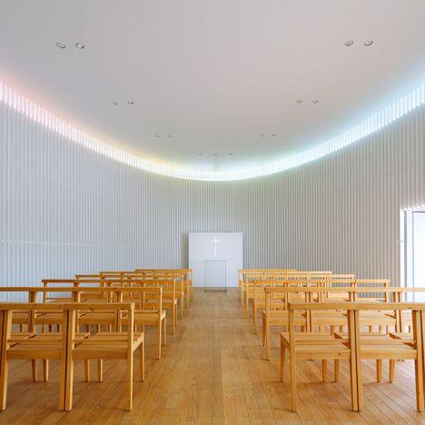 Rainbow hues are cast onto the walls of Kubo Tshushima's Tokyo wedding chapel