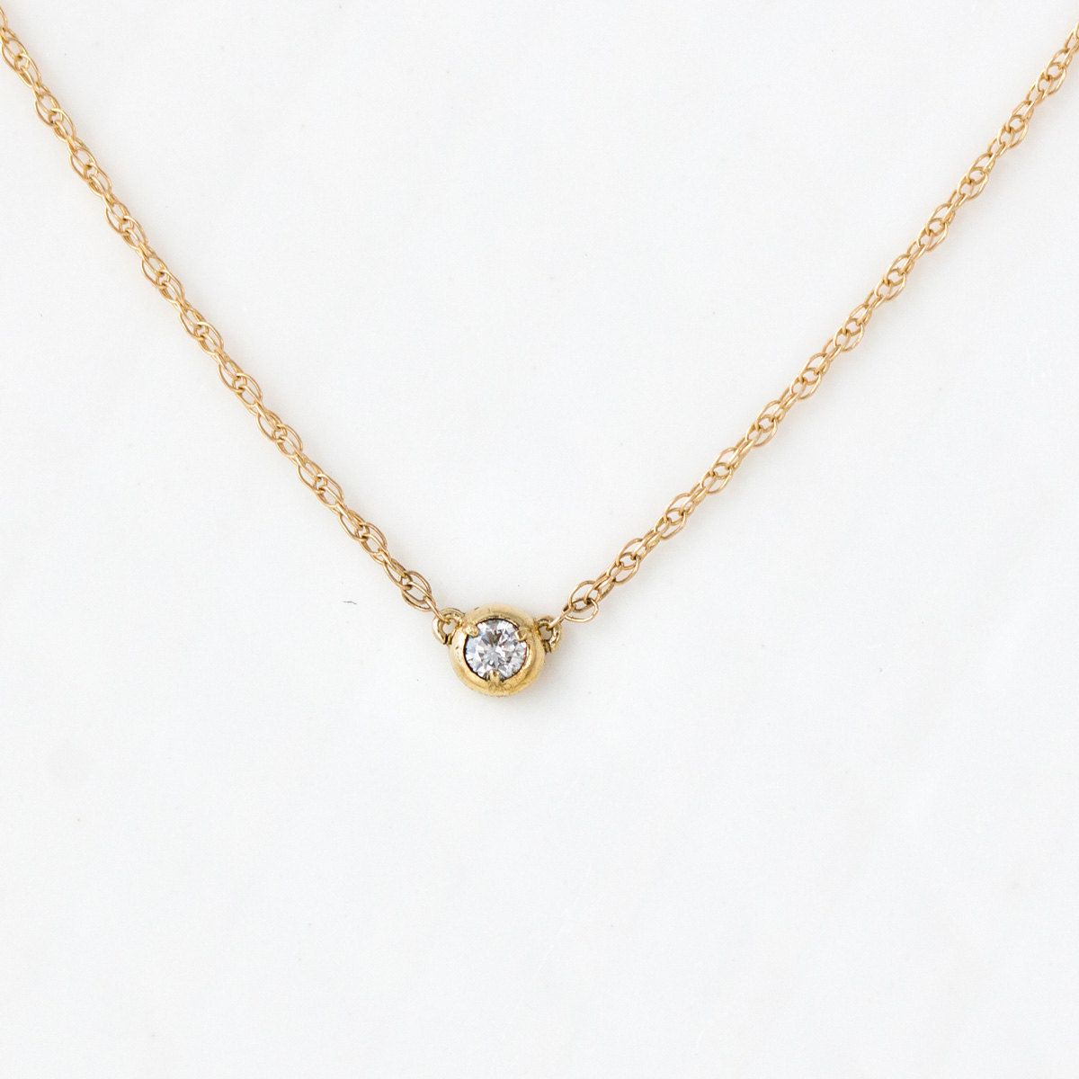 Single diamond necklace in k yellow gold handmade by melanie