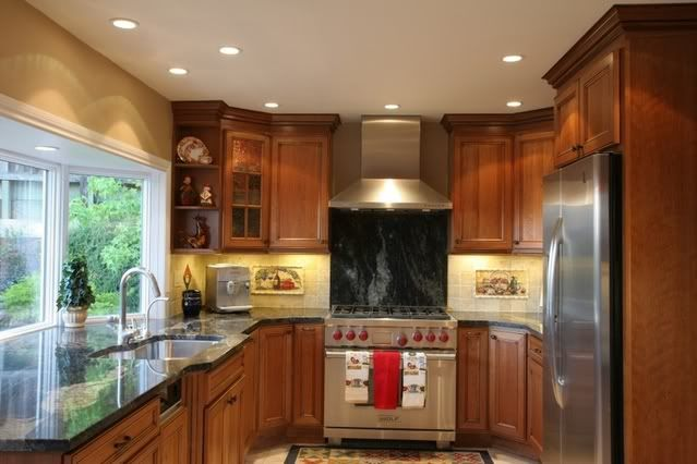 Angled glass kitchen cabinets mf cabinets for Kitchen cabinets 45 degree angle