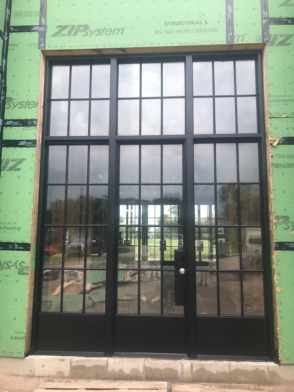 Steel door and window install for a custom home in