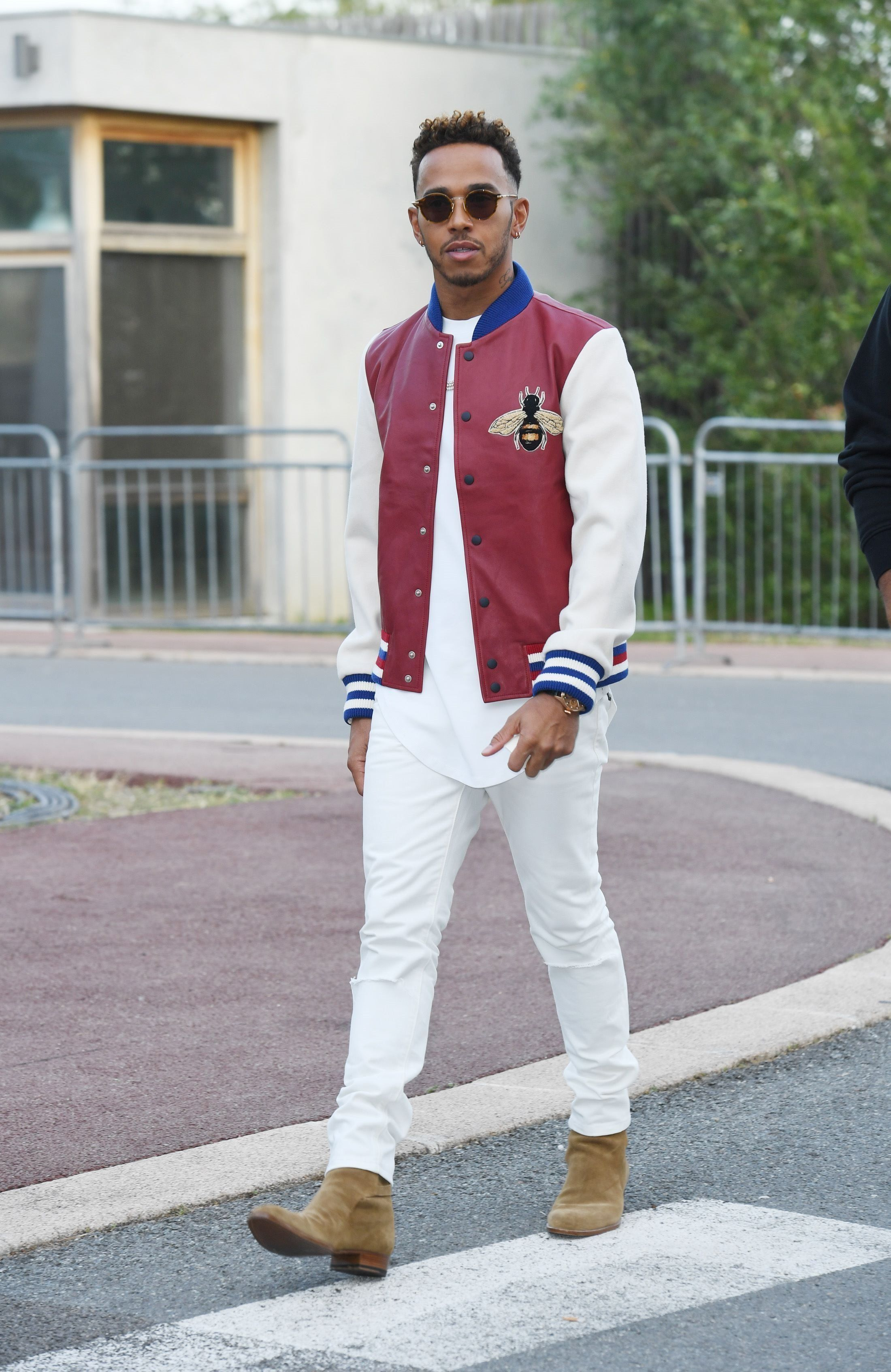 e7098d109f43 Lewis Hamilton wears a Gucci jacket   Saint Laurent boots as he arrives at  a charity gala in Cannes.  cannes2017  racecar  brands