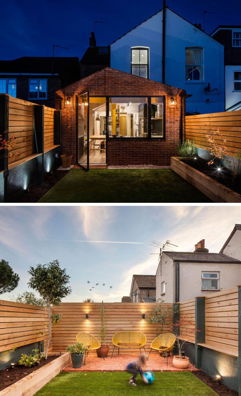 A Brick Extension With Bright Yellow Beams Was Added To A
