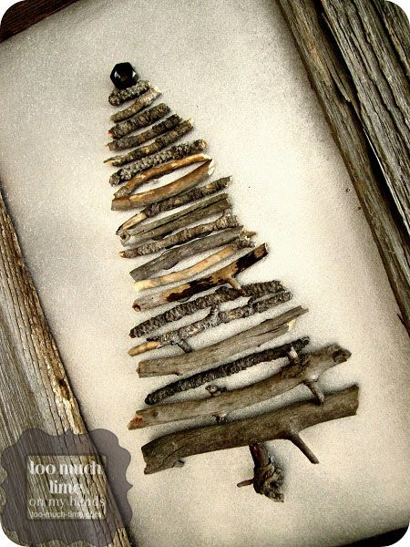Upcycled Christmas Tree Art ... an old fence for the frame, painted cardboard background, twigs and a nut