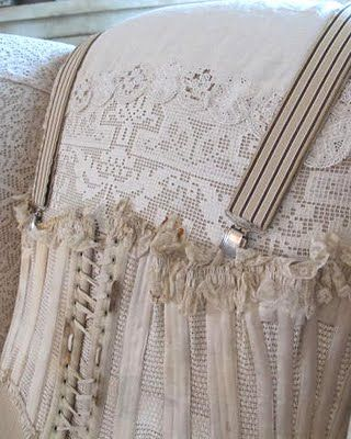 sofa, covered in bits and bobs of corset and lace, *sigh*