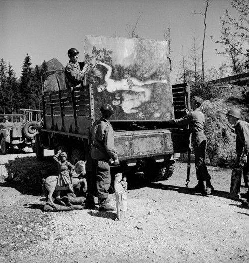 American soldiers of the 101st Airborne loading a truck w. recovered art treasures stolen by German General Hermann Goering