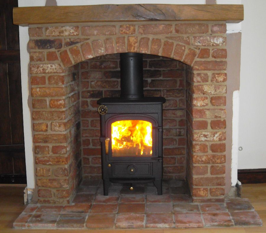 Clearview pioneer wood burning stove with brick arch and Fireplace setting ideas