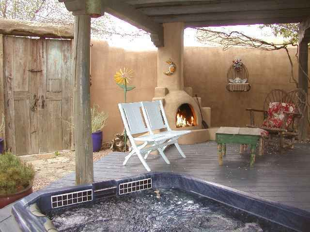 Outdoor Kiva Fireplace At Edge Of Covered Area Arizona Backyard Fire Pit Seating Area Outdoor Living