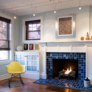 A casual Living Room highlighted with a vivid #blue tile # ... on Fireplace Casual Living id=21873