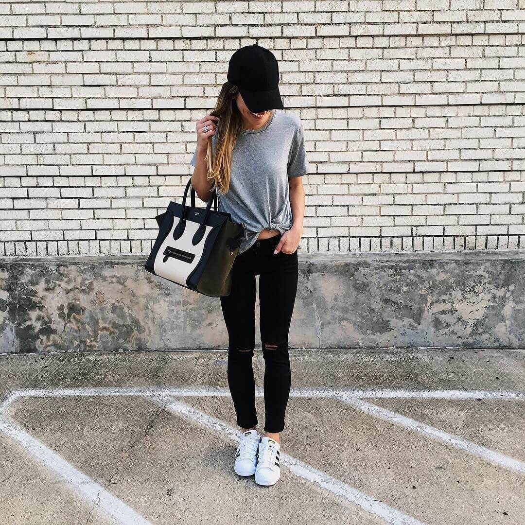 2a40456add6 brighton wearing distressed black jeans and adidas with grey t-shirt