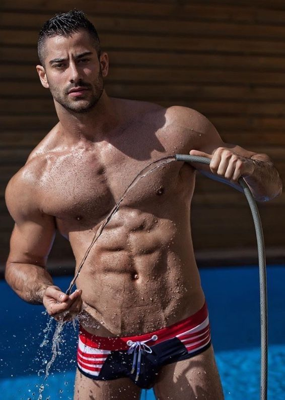 muscly guy tugging in shower