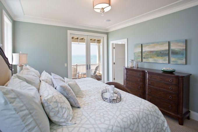Coastal Feel Master Bedroom Serene Blue Walls Sisal Carpet French Doors Leading