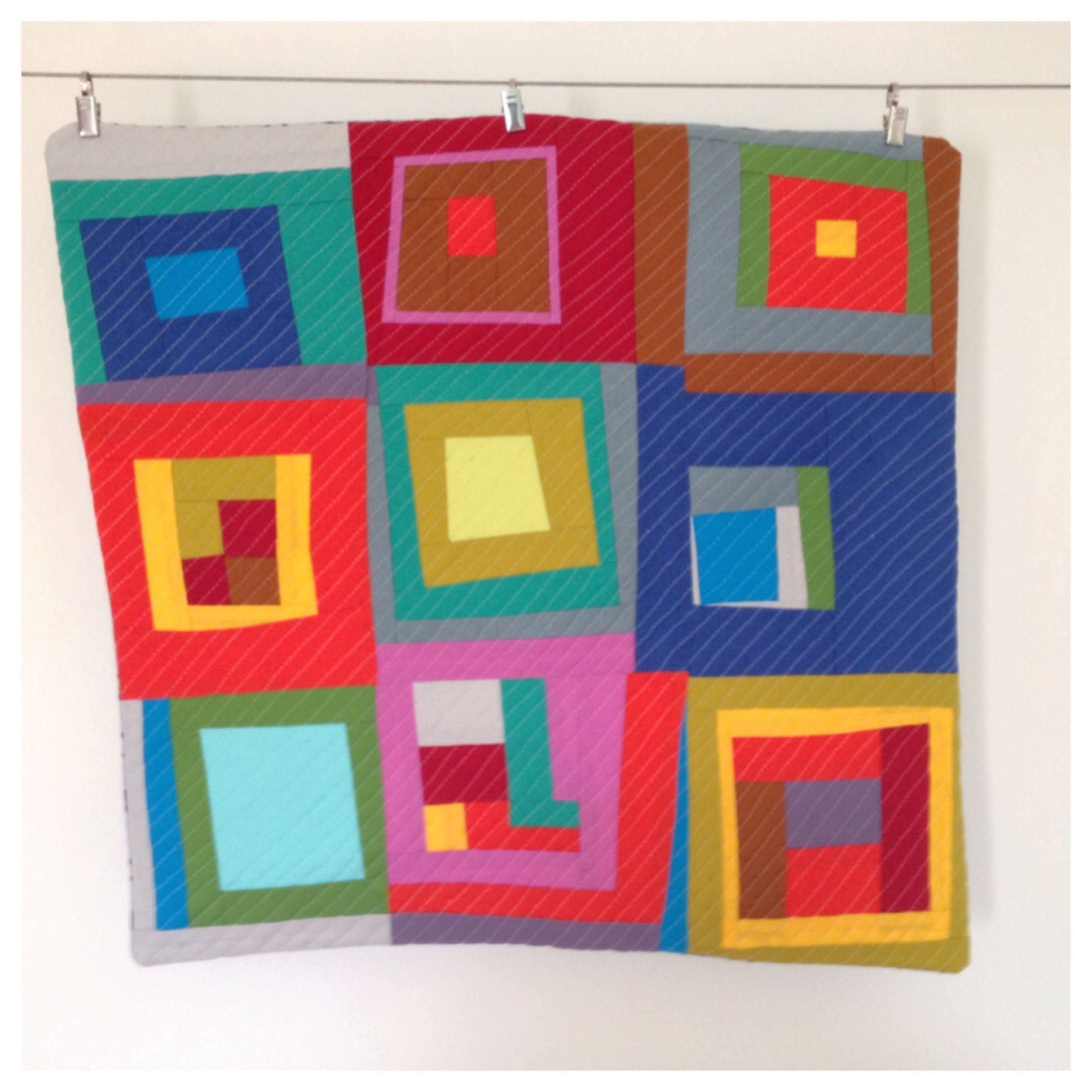Improv block quilted and backed to make pillow cover.