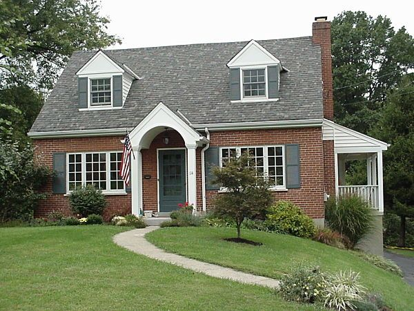 Cape Style Cottage With A Portico By Neal S Design Remodel Nice Entryway Brick Exterior House Cape Cod House Exterior House Exterior
