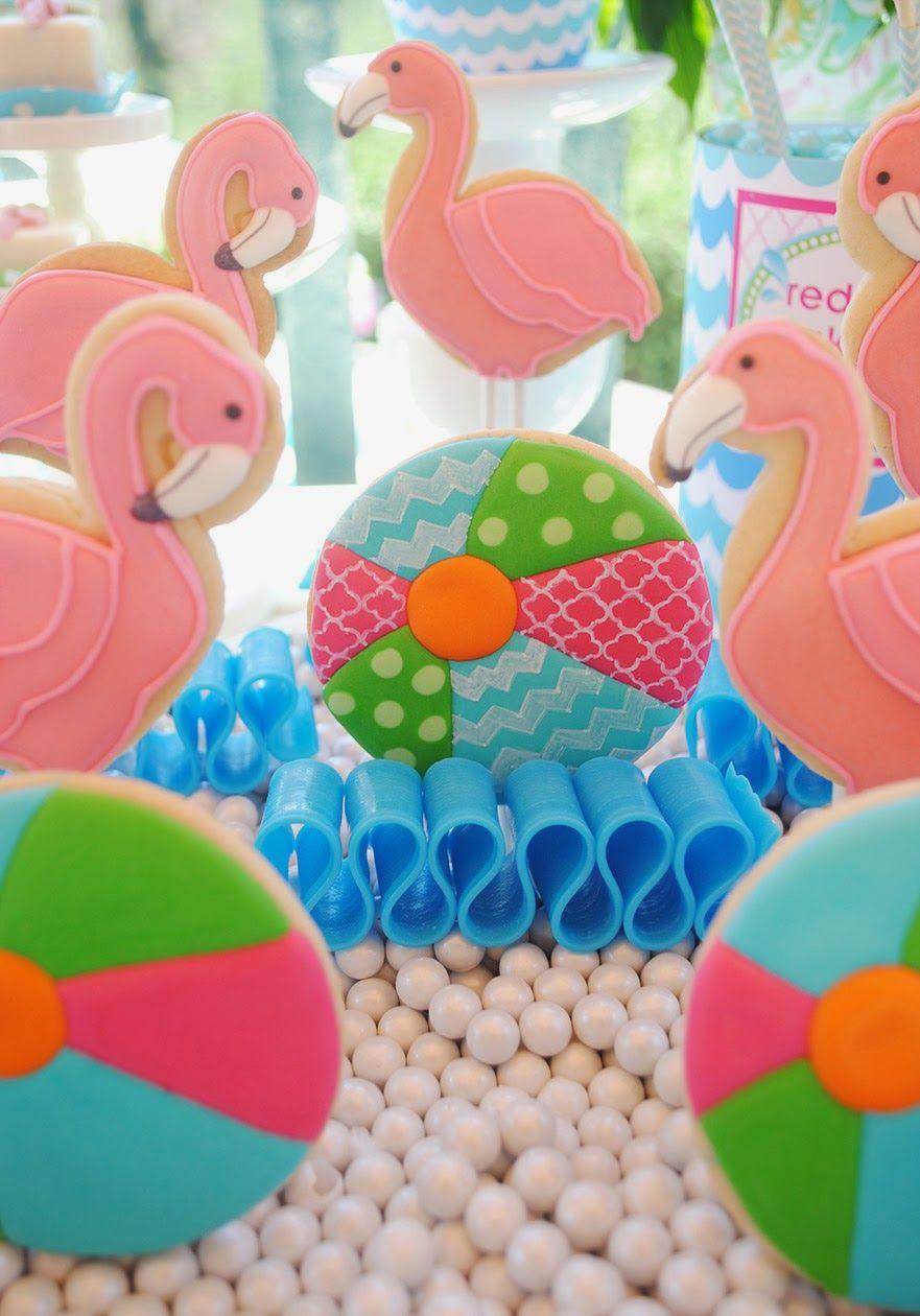 Pink flamingo pool party cookies.