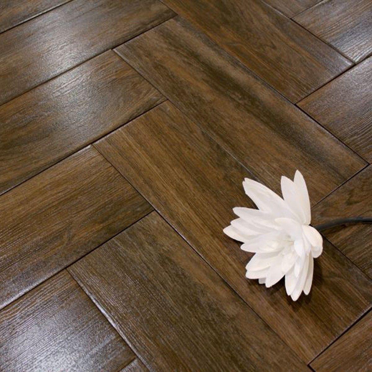 a dark brown wood effect ceramic tile