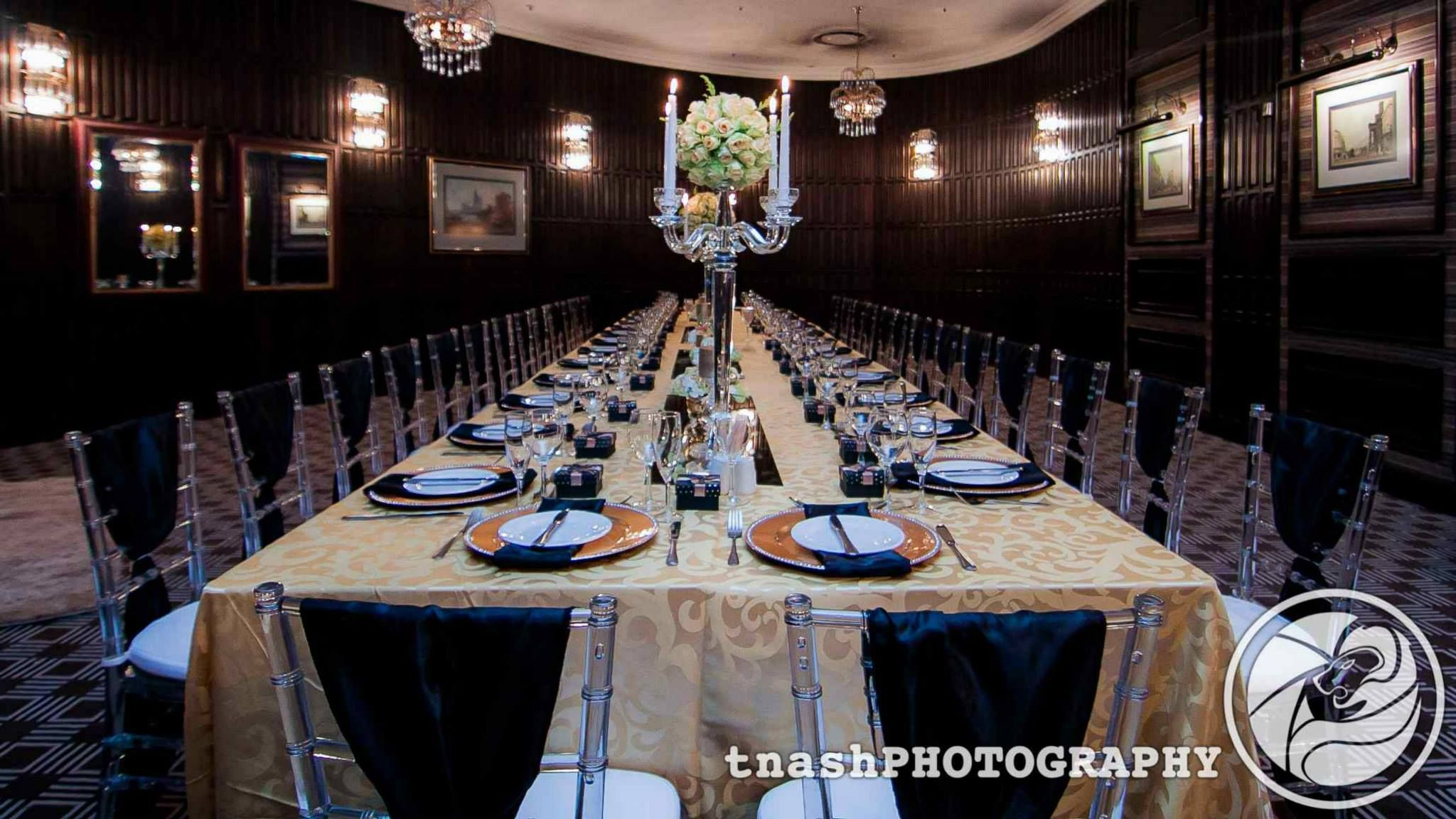 30th birthday dinner set-up. theme was black & gold elegance
