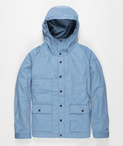 The Nanamica Cruiser jacket is made from 65/35 Bayhead cloth, an incredibly lightweight and durable technical fabric. It has twin front pockets with snap-button closure, button through front and adjustable hood, cuffs and hem. You will also find two hidden pockets on the internal and external rear side.