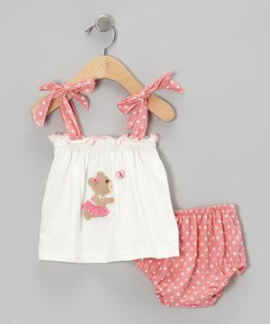 Tied at the shoulders and topped with a darling appliqué, this breezy tank has elastic in all the right places for a snug fit. Paired with a fun print and matching diaper cover, this sweet set is sunshine-ready.