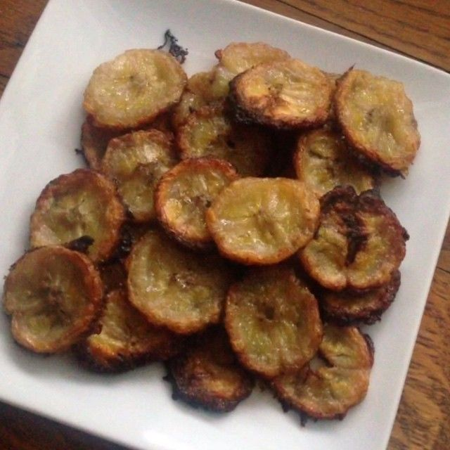Banana chips. Slice thin. Toss in coconut oil. Layer on parchment paper. Bake for 15-20 min at 400F.