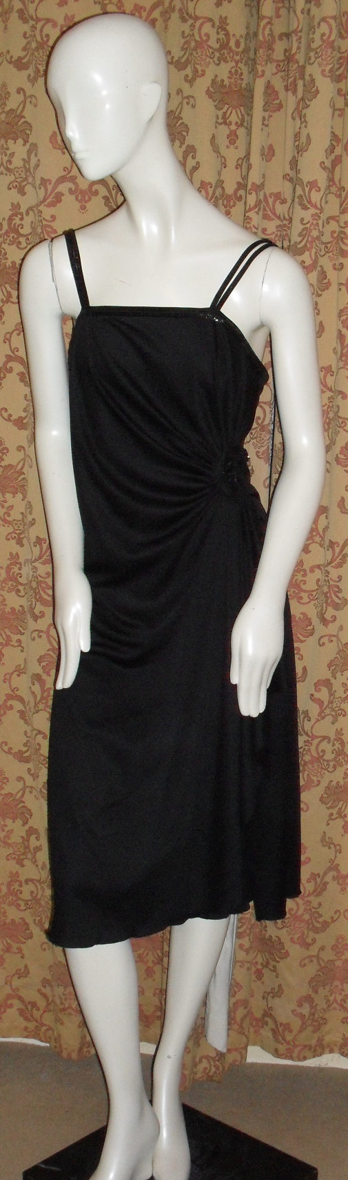 Check out this item in my Etsy shop https://www.etsy.com/uk/listing/249855203/1970s-black-sequin-panel-cocktail-dress