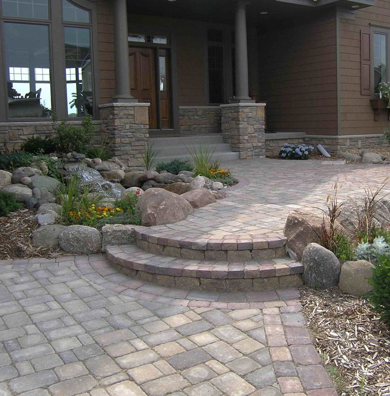 Cobblestone Entryway With Boulders