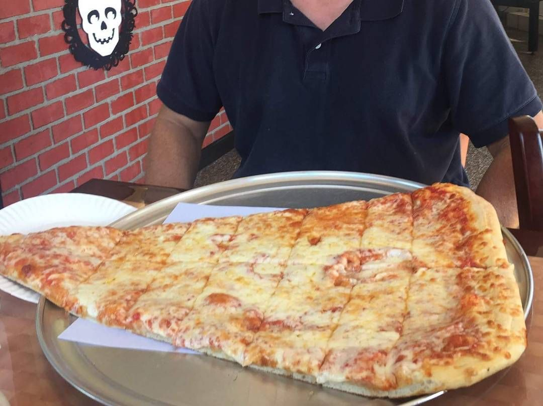 At 2ft Long And Over 5 Lbs The Super Slice At Pizza Barn In Yonkers Ny Is Billed As The Largest Slice On Earth Tag Best Food In Nyc Man Vs