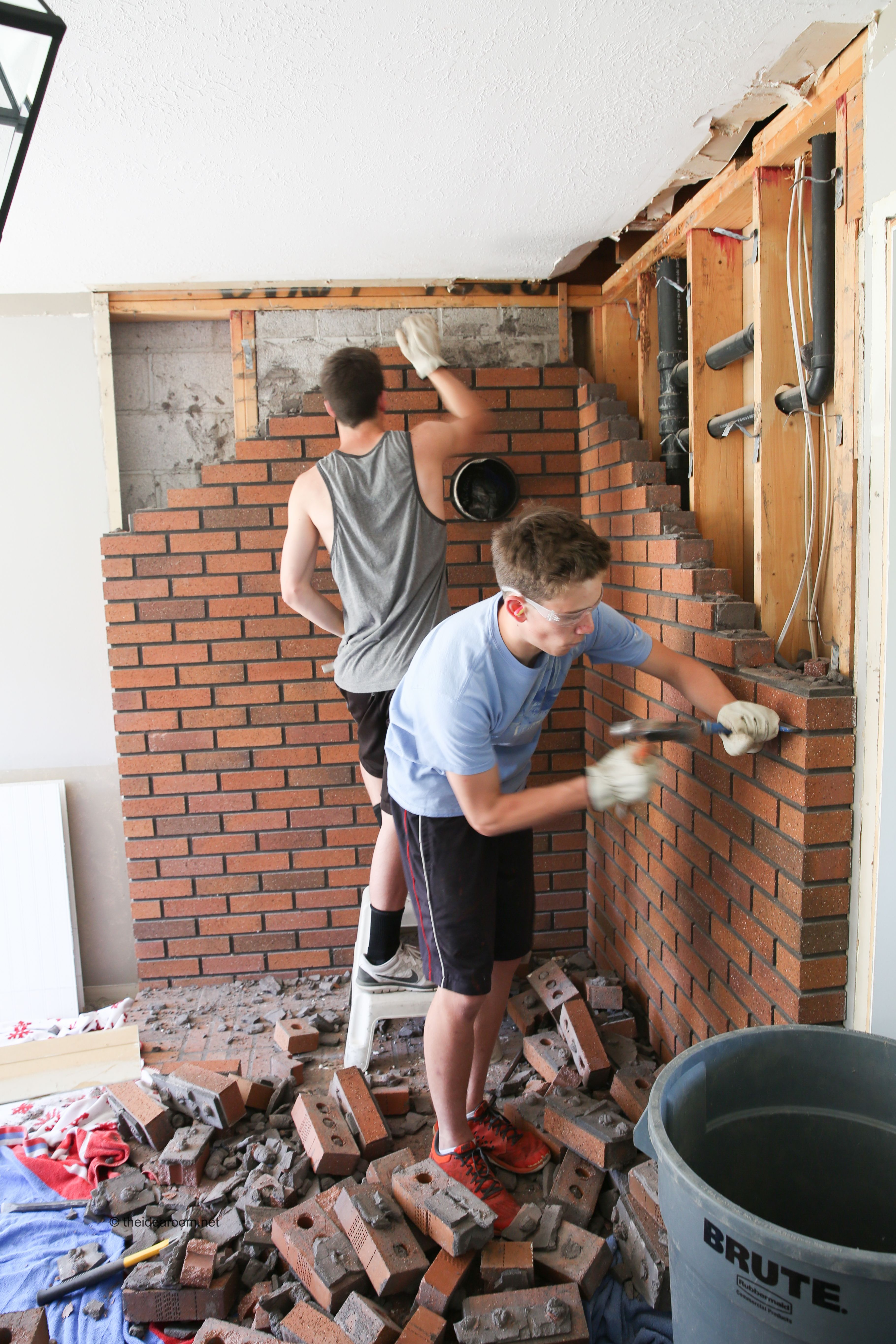 Family room renovation brick fireplace wall brick