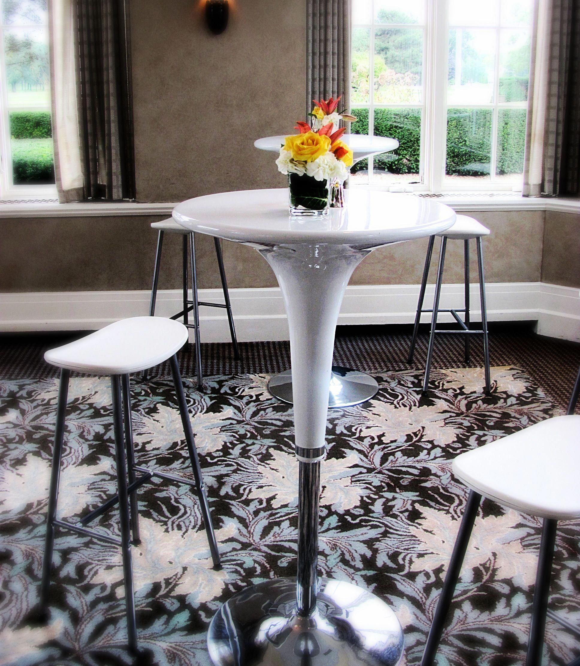 White high top tables also available in black with bright flower