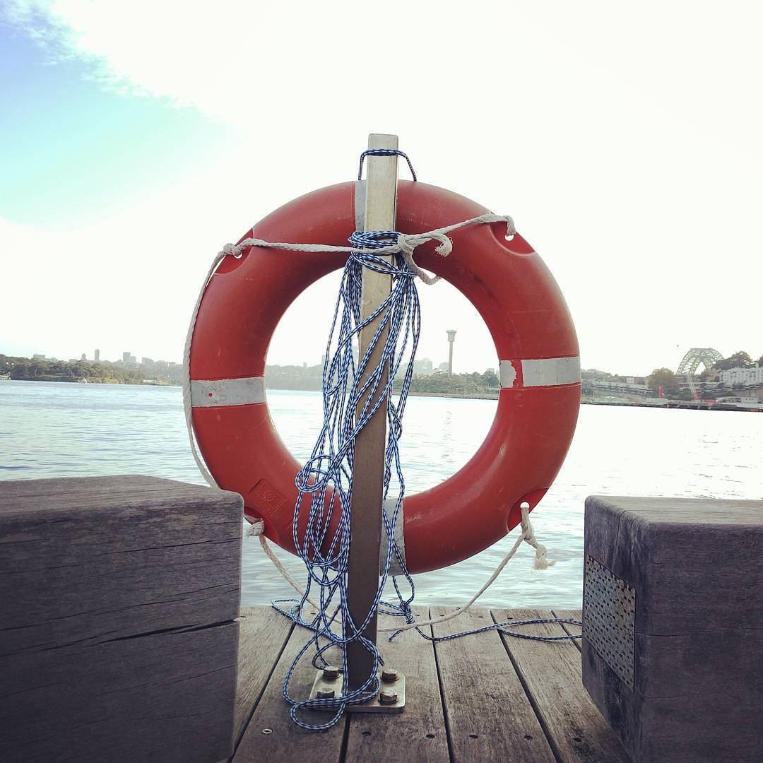 It is interesting how something can be beautiful and yet still cause death. I guess it is good to have a lifesaver around for this reason. #waterviews #sydneyharbourbridge #livesaver #wharf by nathan.seal http://ift.tt/1NRMbNv