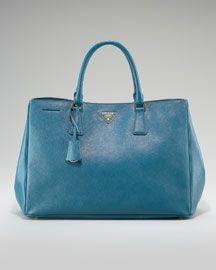 Great Prada bag.  Love the color.