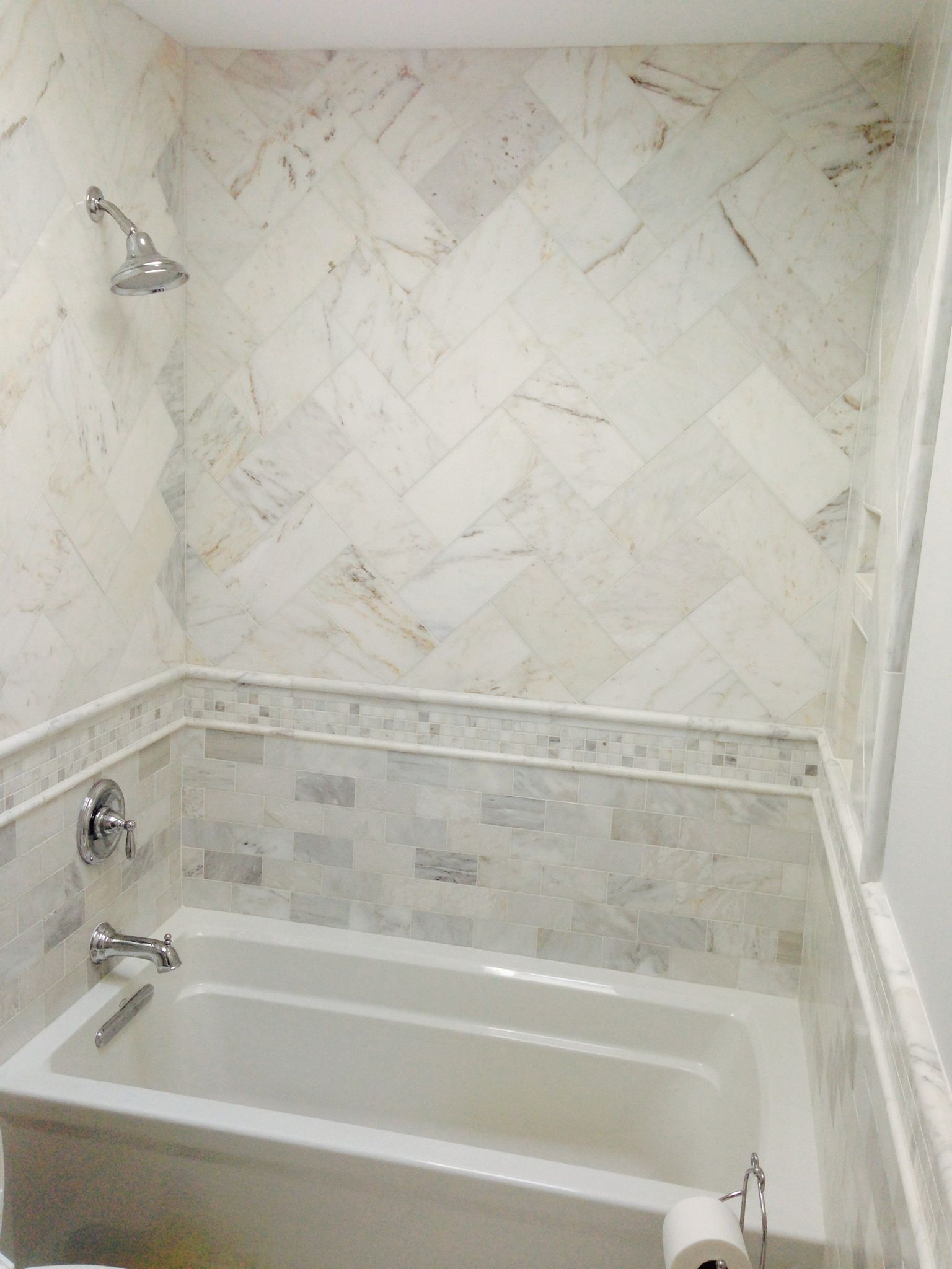 Herringbone patterned shower with custom wrap around band | Showers ...