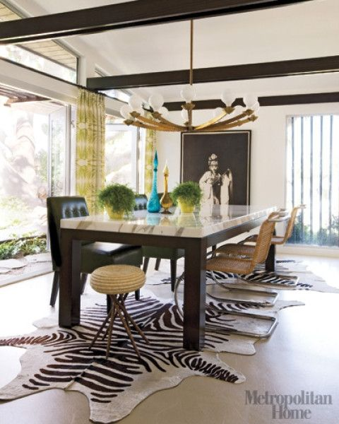 Ultra Mod Chandelier With Mix Matched Chairs And A Zebra