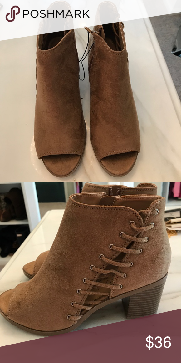 a9a1e5a1b65a2 BNWT open toe ankle booties. BNWT open toe ankle booties. Zip up sides.  Never worn. Size 8.5. Perfect for any spring