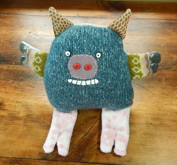 Knitagain pig - squeezy barnyard friend with a curly tail. $32 at kittyallen.etsy.com  Made from recycled sweaters.
