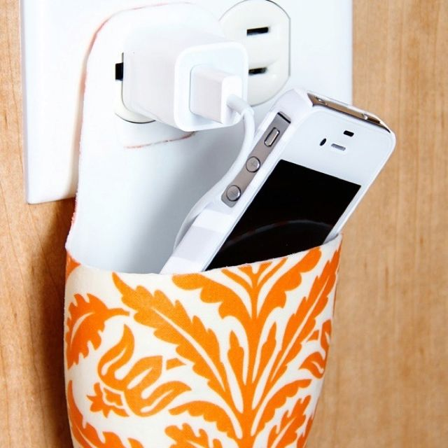 This is so awesome! You take a old lotion or soap bottle and cut it out to this shape and use it to hold your phone while you charge your phone! So going to do this! (: