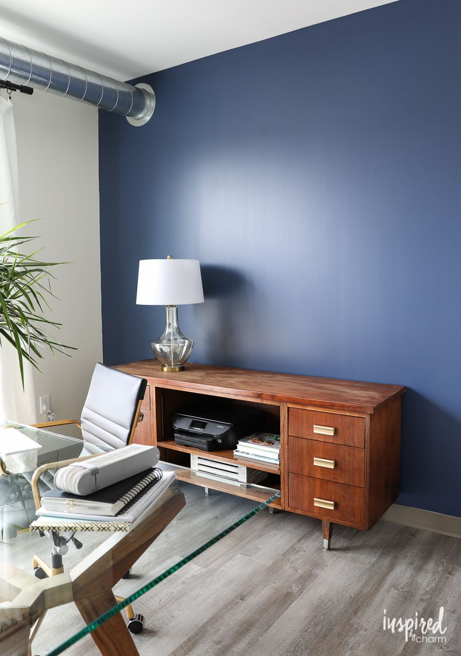 The navy blue accent wall is sherwin williams indigo batik feature wall paint for the home office inspired by charm